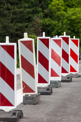 barrier of red and white signs for marking road works