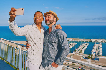 a gay couple using a mobile phone