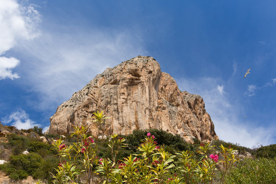 Calp Costa Blanca Spain view up to Penon de Ilfach the large rock from the walk around the bottom of the famous landmark