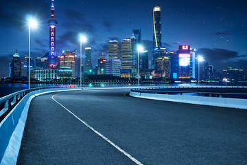 Spoed Foto op Canvas Nacht snelweg High speed corner overpass asphalt road with Shanghai cityscape , night scene .