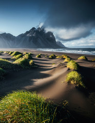 Wall Mural - Unique view on the green hills with sand dunes. Location Stokksnes cape, Vestrahorn, Iceland.