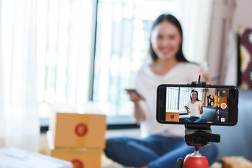 Beauty blogger demonstrating how to make up and review products on live broadcast use smartphone, life of an influencer