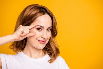 Close up photo beautiful amazing she her foxy lady hold arm hand face cheek cheekbone applying nourishing anti-age cream pure skin no wrinkles wear casual white t-shirt isolated yellow background