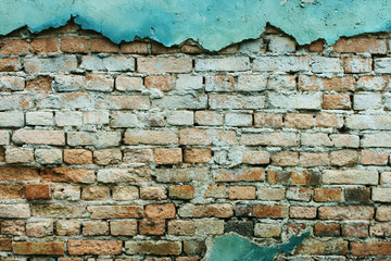 Red cracked brick wall with floor texture background.