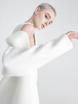 Young model putting on white jacket
