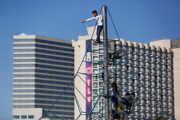 Children play on a climbing structure at the Eurovision Village, an area dedicated to fans of the 2019 Eurovision Song Contest, in Tel Aviv, Israel