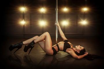 Sexy woman dance in studio. Pole dancer in studio background.