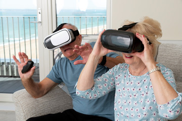 Portsmouth UK, May 2019. Elderly couple having fun wearing virtual reality goggles