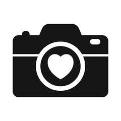 Camera with heart on white background icon