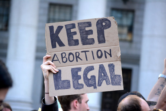 People protesting new, strict abortion laws sweeping parts of the United States in New York City.