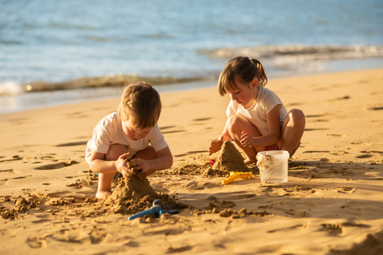 Kids making sand castle on the beach