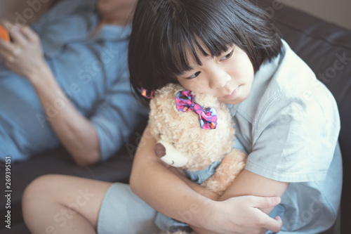 Admirable Asian Female Kid Sit On Couch Hug A Bear Sad Looking Outside Pdpeps Interior Chair Design Pdpepsorg