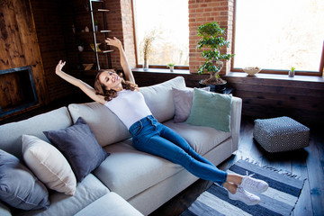 Wall Mural - Full length body size view of her she nice attractive feminine stylish cheerful cheery wavy-haired lady sitting on comfortable sofa having fun time rest at industrial loft wooden brick style interior