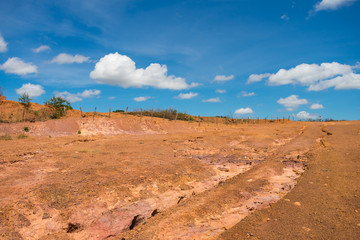 Dry, orange soil and blue sky in the countryside of Oeiras - Piaui state, Brazil (Sertao landscape)