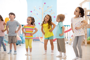 Group of children are engaged indoor physical exercise