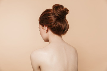 Back view photo of a young redhead woman