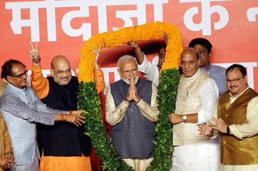 BJP President Amit Shah and Indian Prime Minister Narendra Modi react after the election results in New Delhi