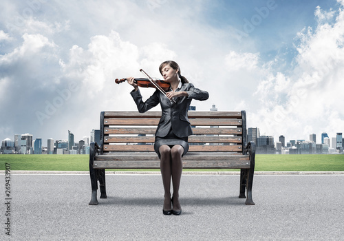 Stupendous Young Woman With Violin Sitting On Wooden Bench Stock Photo Ocoug Best Dining Table And Chair Ideas Images Ocougorg