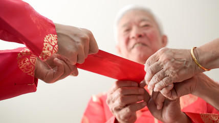 Hand giving red envelop for Chinese new year festival