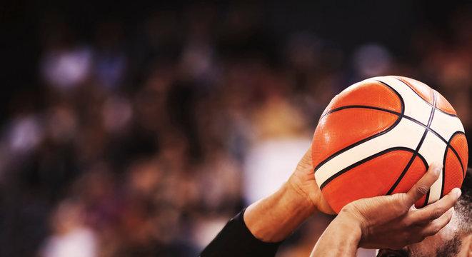 basketball player shooting three pointer