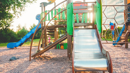 Image of empty big wooden playground at park with lots old ladders, stairs and slides