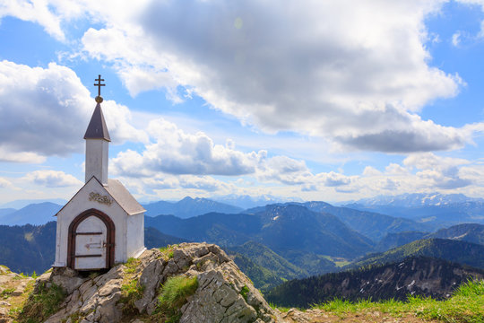 small chapel at Mountain Hochgern with view to alps on sunny summer day