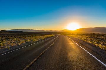 USA, Nevada, Long winding road at sunset