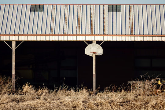 Basketball hoop and backboard on exterior of shed on a Midwestern farm