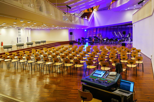 concert hall before concert, empty chairs, musical instruments and sound board