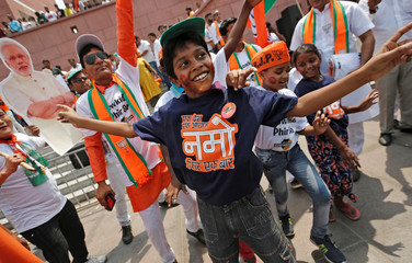 Bharatiya Janata Party (BJP) supporters celebrate after learning the election results at party headquarters in New Delhi
