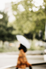 blurred woman with umbrella