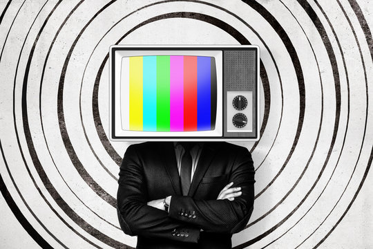 Businessman with no signal vintage tv set instead of head on white circle pattern background