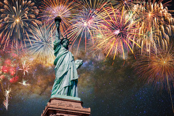 Statue of Liberty over the Multicolor Fireworks Celebrate with the milky way background, 4th of July and Independence day concept