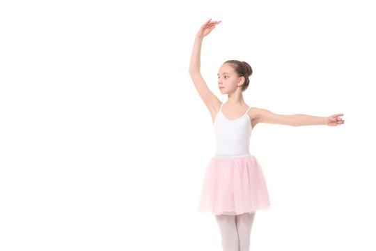 young girl ballerina posing on white background