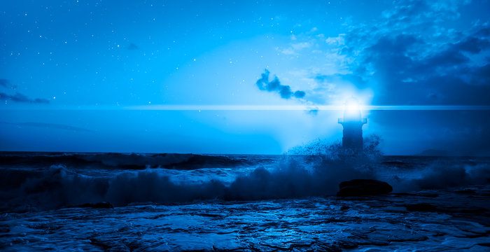 Night sky with full moon in the clouds with lighthouse