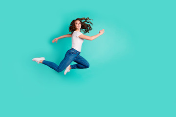 Wall Mural - Full length body size profile side view of her she nice-looking attractive lovely cheerful cheery slim fit thin wavy-haired lady having fun time isolated on bright vivid shine blue background