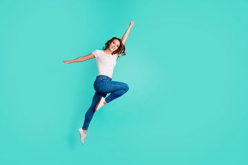 Wall Mural - Full length body size view of her she nice-looking attractive lovely cheerful slim fit thin slender wavy-haired lady active activity life lifestyle isolated on bright vivid shine blue background