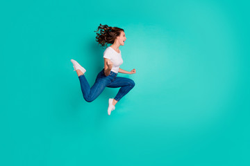 Wall Mural - Full length body size view of nice attractive lovely sporty slim fit crazy cheerful cheery overjoyed satisfied wavy-haired lady having fun reaction isolated on bright vivid shine blue background