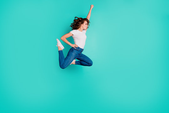 Full length body size view of her she nice attractive lovely sportive slim fit thin adorable purposeful wavy-haired lady raising hand up isolated on bright vivid shine blue background