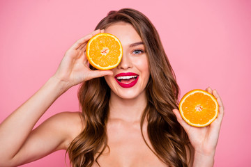 Close up photo beautiful amazing she her lady arms two orange slices hide one eye perfect allure lips natural body care useful influence wear no clothes naked nude isolated pink bright background
