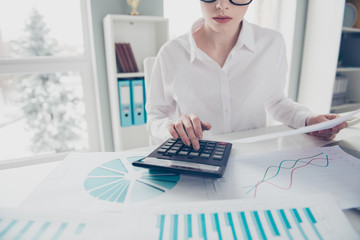 Cropped close up photo beautiful she her business lady count freelance salary calculating income investment hold watch compare data hands arms calculator notebook table wear formal-wear bright office