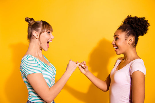 Profile side view photo of funny funky lady scream shout excited amazed positive cheerful wavy curly hairdo style stylish trendy top-knot shadow bright summer t-shirt isolated on yellow background