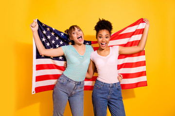 Portrait positive cheerful content joy lady hold hand citizen citizenship liberty patriot beautiful wavy curly top-knot bun trendy style stylish t-shirt jeans trip abroad isolated yellow background