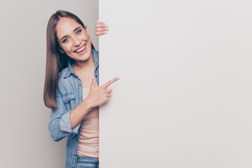 Portrait of her she nice attractive lovely shine cheerful cheery positive straight-haired lady pointing forefinger at big large promotion ad advert isolated over light white gray background Papier Peint
