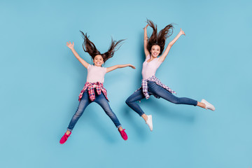 Full length body size view portrait of two nice attractive cheerful cheery careless carefree healthy straight-haired girls having fun rejoicing isolated on bright vivid shine blue turquoise background