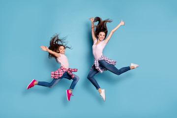 Full length body size view portrait of two nice attractive cheerful careless carefree sportive straight-haired girls having fun hipster look isolated on bright vivid shine blue turquoise background