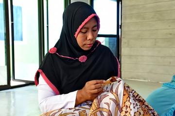 batik maker while working in a studio, to throw cloth in Batang / Jawa Tengah Indonesia, May 22, 2018
