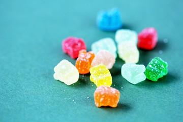 cbd gummy bears vitamin on green background