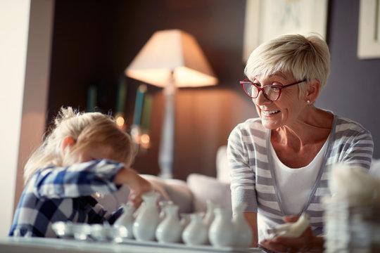 Grandmother with granddaughter having fun