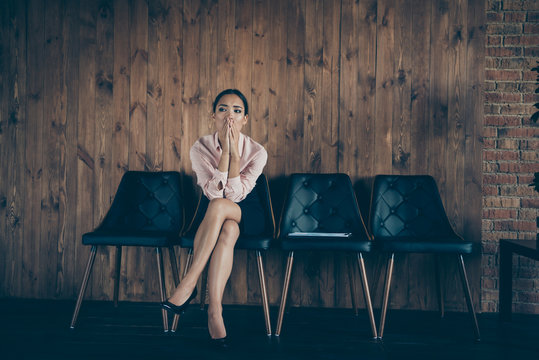 Portrait of her she nice attractive worried lady qualified specialist partner sitting on chair waiting for meeting ceo boss chief recruiter at modern industrial loft interior style work place station